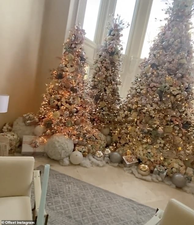 So many:The center tree was the tallest with medium ones next to it and smaller ones on the end; they all had similar decorations - featuring pastel hues