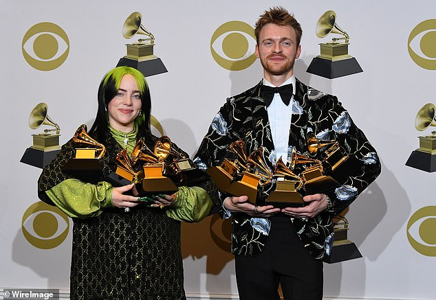 Sharing the glory: The collaborators are seen at the 62nd Annual Grammy Awards in January, where Eilish's album When We All Fall Asleep, Where Do We Go? won multiple awards