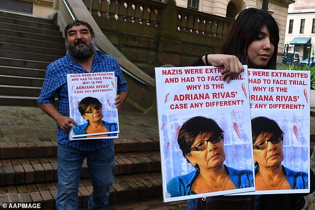 Members of the Chilean Australian community from the National Campaign for Truth and Justice in Chile, Australia wear pictures of some of the victims following a brief court appearance by Adriana Rivas at Central Local Court in Sydney on April 2, 2019