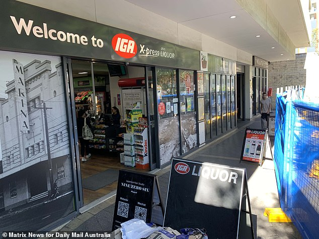 Retailers were blindsided when Mascot Towers Owners Corporation told them on December 10 that access to their premises would be blocked due to safety concerns. The IGA is pictured shortly before the last panel of fencing blocking access from Church Street was erected