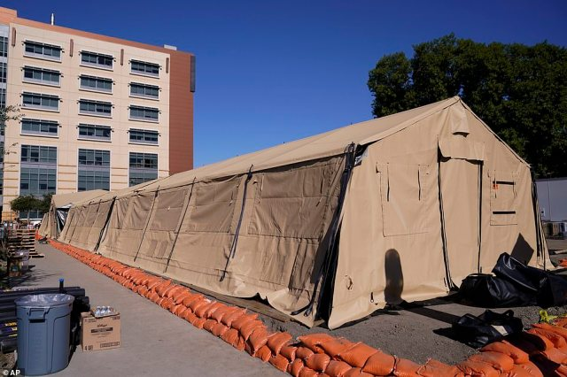 A mobile field hospital is set up at UCI Medical Center, Monday in Orange, Calif. California's overwhelmed hospitals are setting up makeshift extra beds for coronavirus patients, and a handful of facilities in hard-hit Los Angeles County are drawing up emergency plans in case they have to limit how many people receive life-saving care