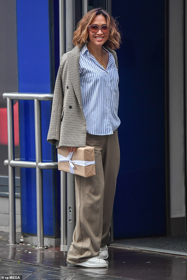 She's got style:Myleene complemented the look with white trainers and a houndstooth jacket