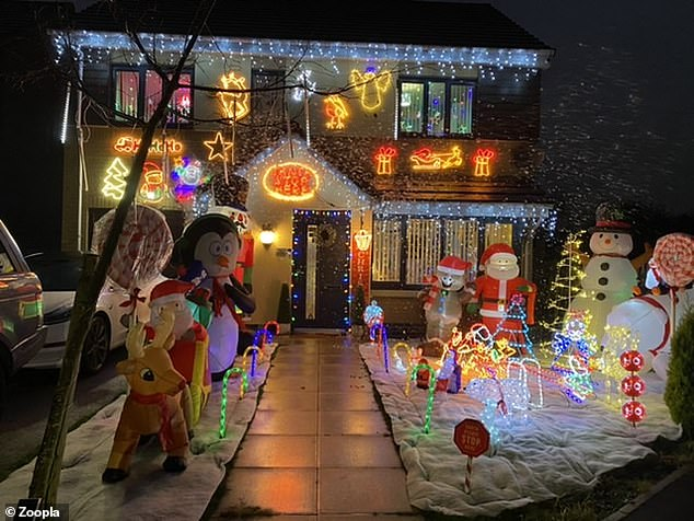 Inflatable snowmen, penguins and reindeer are keeping an eye out in front of this house - so you better not be on the naughty list!