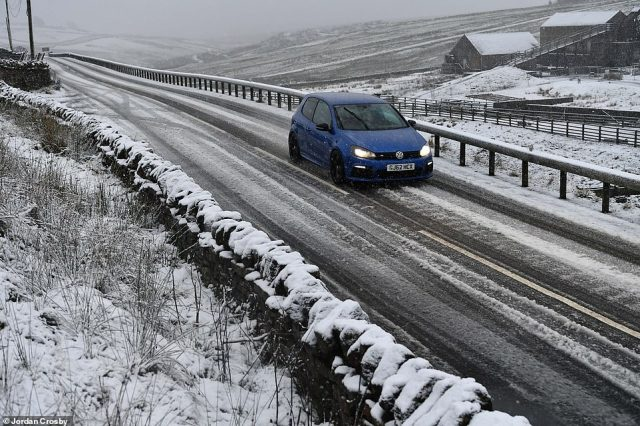 A vehicle braves the roads of County Durham, north east England, where it looks as if a white Christmas might be on the cards