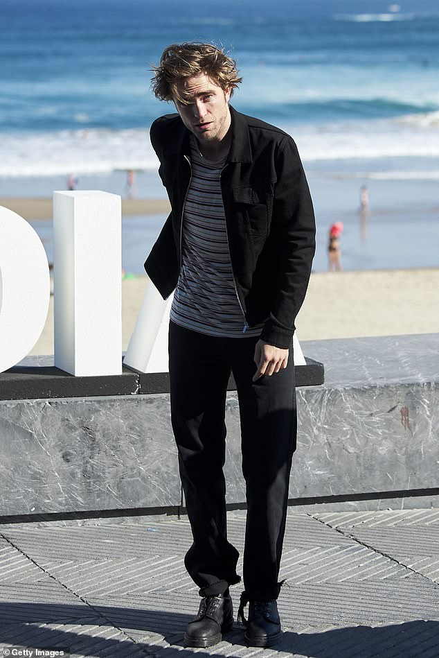 Style inspiration: As well as posing up a storm in an eclectic range of ensembles, the star revealed that his style inspirations include Robert Pattinson. Pictured in 2018