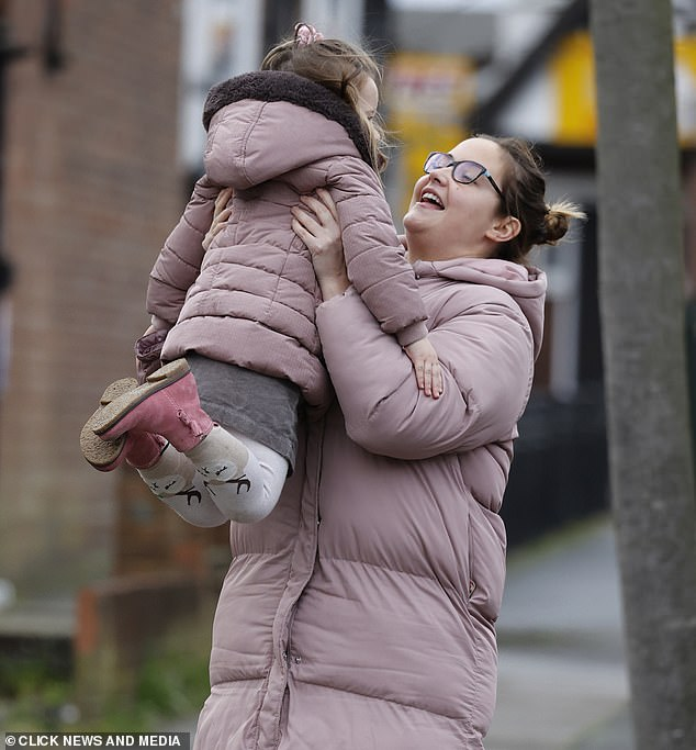 Me and you:Jacqueline teamed her pale pink coat with leggings and white trainers and her glasses as she headed to the local shop with Mia