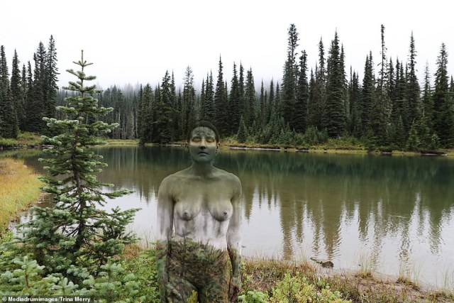 Brr!On the day of a shoot, Trina would start to paint her model 30 minutes before sunrise — even though that often meant they were out naked in freezing temperatures (pictured:Reflection Lakes, Mt. Rainier National Park)