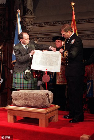 Pictured:The Duke of York hands over the Royal Warrant for the safe keeping of the Stone of Destiny to Scottish Secretary Michael Forsyth in 2001