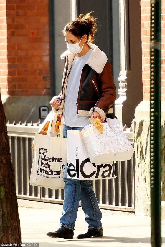 Compiling a list, checking twice: Katie didn't let many bags slow her down as she went out in the sun carrying numerous purchases