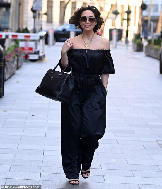 Myleene Klass tailors a chic figure in a black satin jumpsuit with a bandeau and matching sandal heels