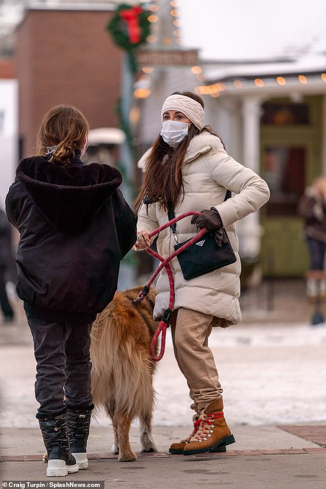 Puppy love:Earlier in the day, Kyle and Portia were seen taking out their adorable pup for a walk around the town center