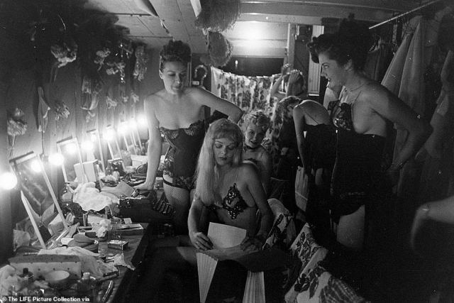 Burlesque star Gypsy Rose Lee (left) and other dancers prepare backstage for their performance in Memphis.