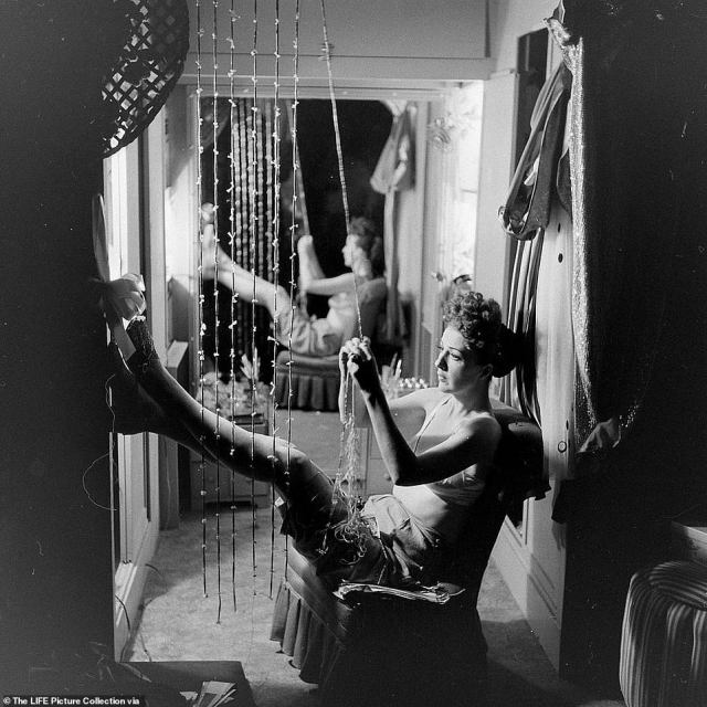 Life Magazine sent their esteemed photographer, George Skadding to cover Gypsy Lee while on tour across America. Skadding was better known for photographing American presidents, but his set of images revealed a different side to the unknowable and elusive woman who was famous for taking off her clothes. Above, Gypsy untangles a necklace in her dressing room during an unprecedented moment of stillness between shows