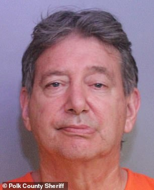 Mark Phillips, 62, is pictured in his photo after the alleged domestic violence incident on December 14