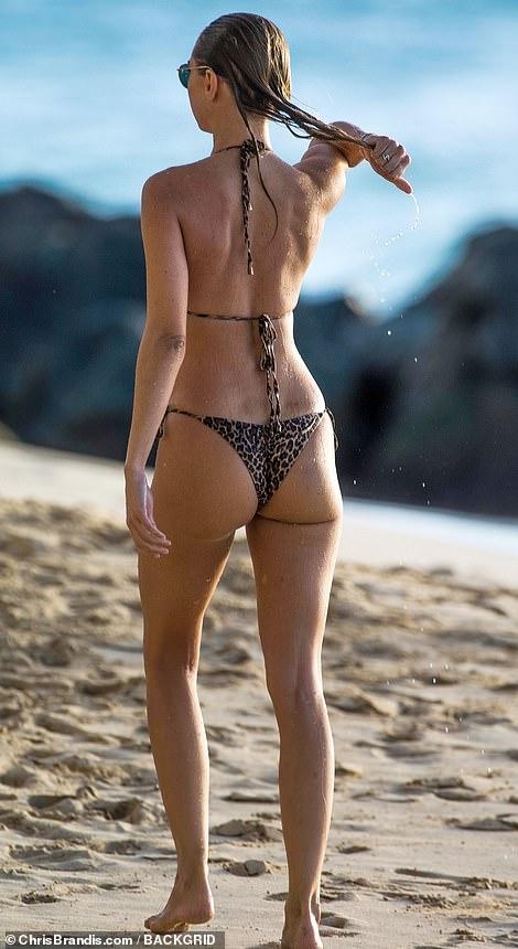 Walk on the wild side: The star put on a cheeky display in the leopard print bikini bottoms