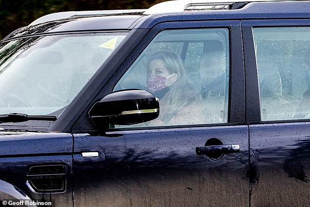 Sophie,Countess of Wessex, is pictured wearing a flowery pink face mask as she drove away from the service today
