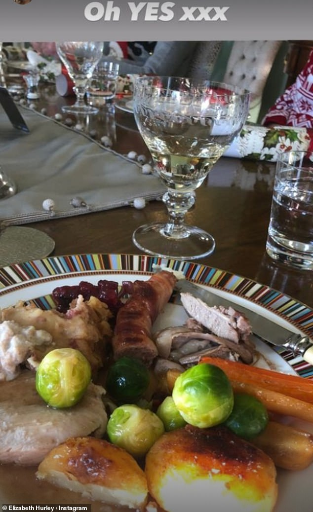 'Oh YES':Elizabeth captured her Christmas dinner complete with golden roast potatoes and gravy