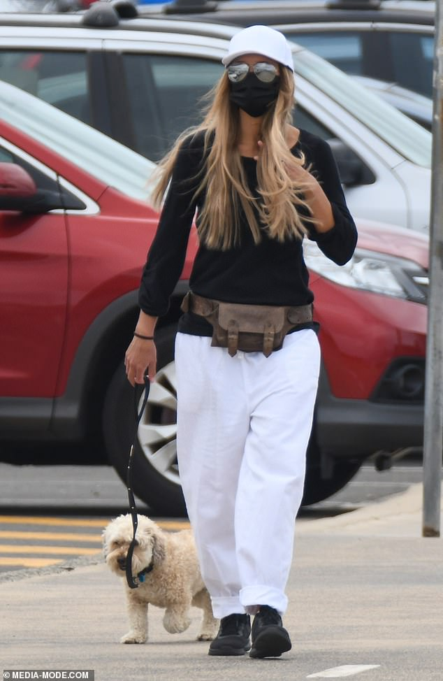 Sharni Vinson goes incognito in a face mask and sunglasses as she takes her dog for a walk