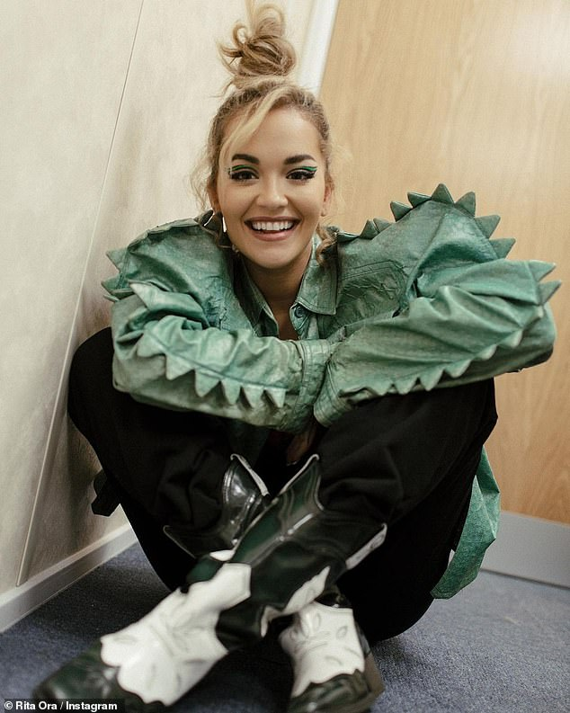 Rita Ora dons a kooky green jacket as she celebrates the return of The Masked Singer