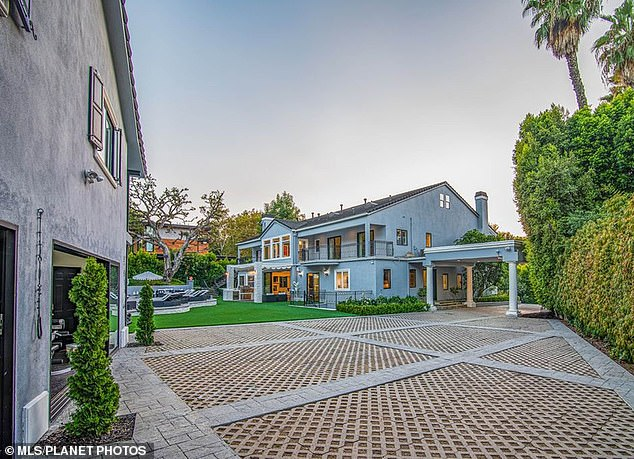 Even better: Four years ago, she bought Bing Crosby's one-time, stunning home located in Toluca Lake, a wealthy area just outside of Los Angeles proper, which was owned by Megan Fox and Brian Austin Green and featured in Bravo show Flipping Out