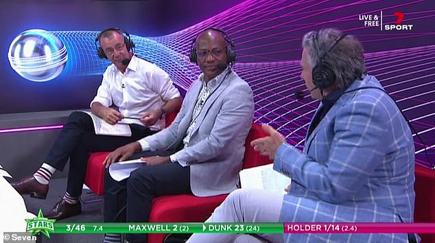 Oh dear: Sports commentator Andrew 'Andy' Maher, 56, (left) suffered a fashion faux pas by wearing long white socks during live broadcast on Saturday. Pictured (left) with Trinidadian cricketerBrian Lara, 51, (centre) andcricket coach Brad Hodge (right)