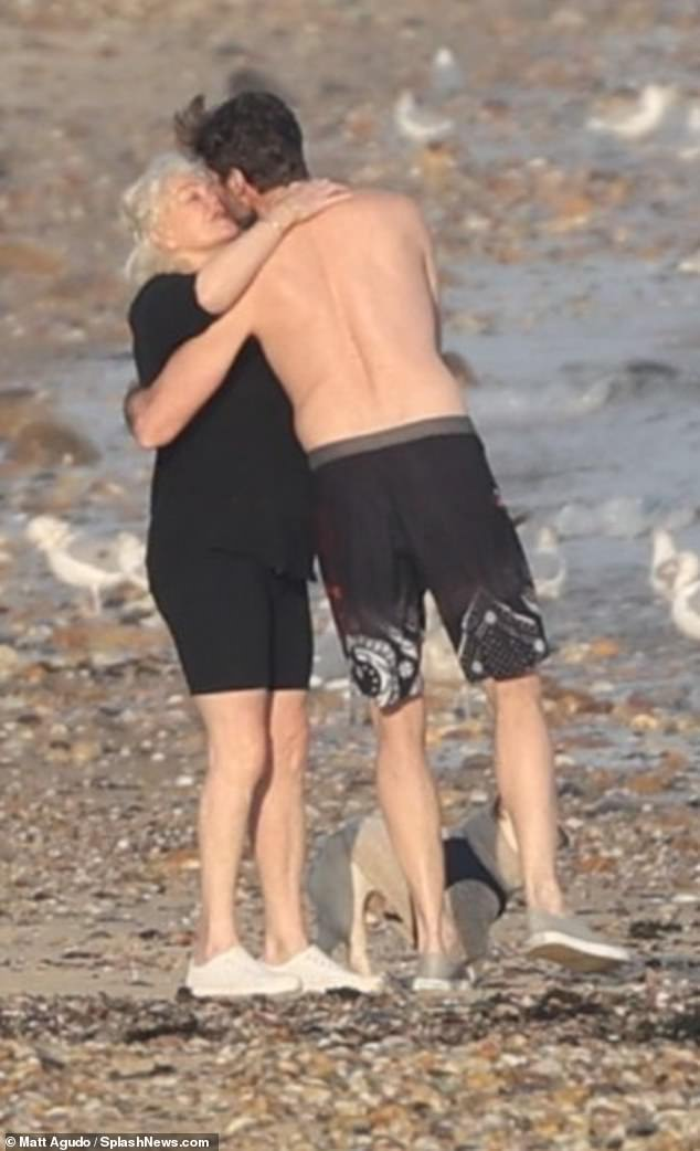 Heating things up! Hugh Jackman, 50, and his wife Deborra-Lee Furness, 65, packed on the PDA as they hit the beach for an icy swim in The Hamptons on Thursday