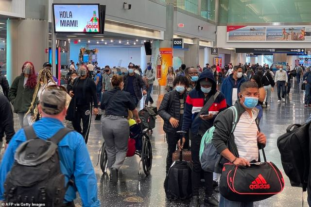 Miami International Airport was bustling with travelers on Christmas Eve despite the raging coronavirus pandemic