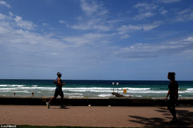 Premier Gladys Berejiklian urged residents to be patient and promised further announcements on restrictions would be made in the lead-up to New Year's Eve (pictured, Manly on Boxing Day)