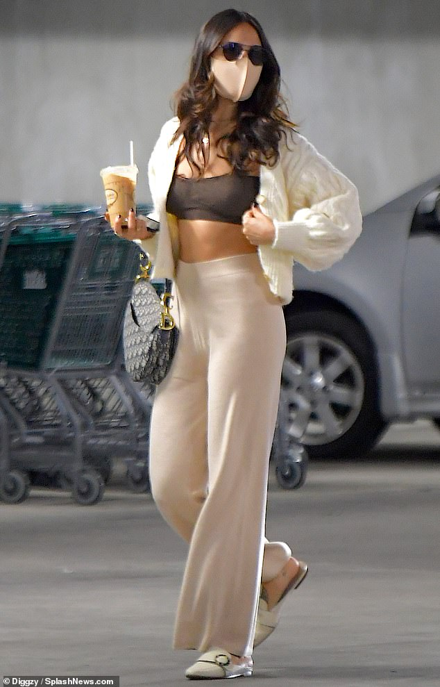 Serving body: Eiza González flashed her tight tummy Saturday in a brown crop top, as she stepped out for a grocery run with her rumored boyfriend at Whole Foods in Los Angeles, after reportedly spending Christmas together at her house
