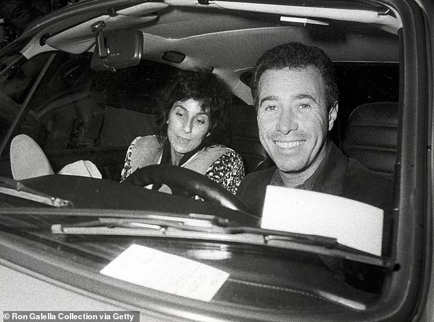 Entertainment mogul David Geffen (right) and his then-girlfriend Cher are pictured outside of La Scala in Beverly Hills in January 1983