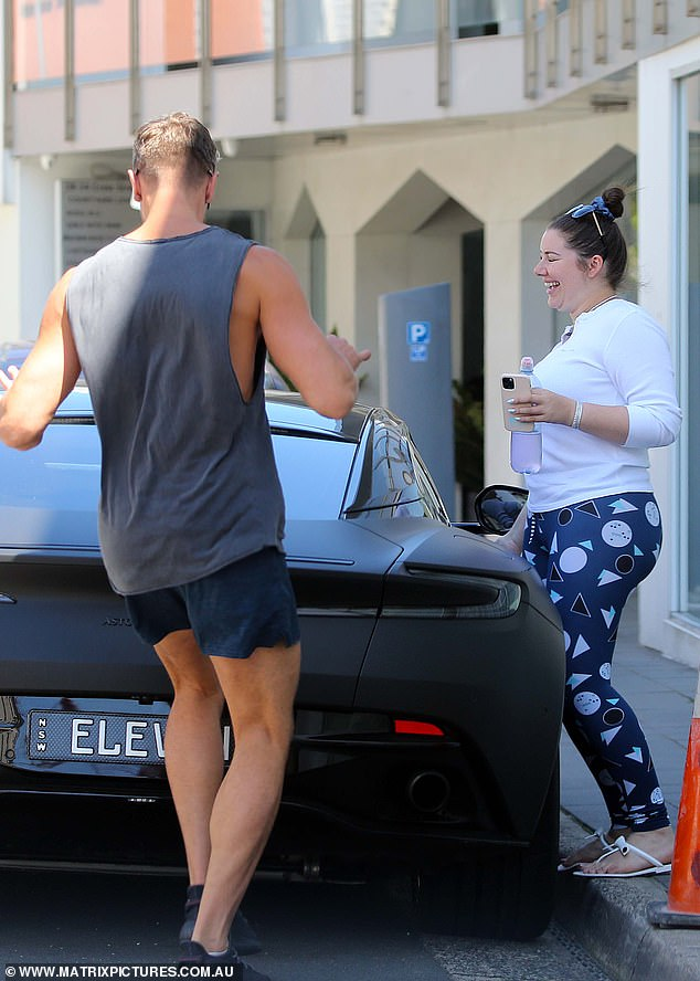 Nice ride: The pair then hopped into the socialite's pricey Aston Martin car