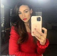 Michelle Keegan wows in a scarlet jumper as she jokingly celebrates Boxing Day