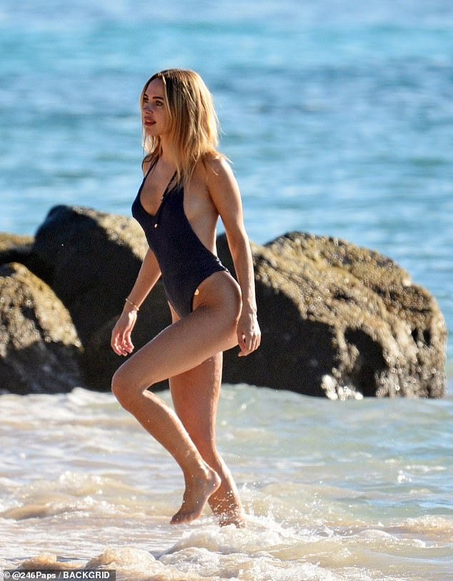 Tanned: Kimberley looked sunkissed as she stepped from the sea