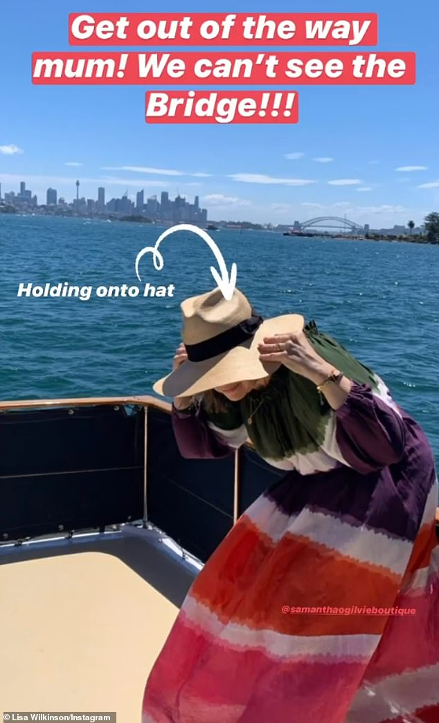 Holding on tight: Lisa also hilariously captured the moment she held onto her hat for dear life, before it was whisked away into the harbour