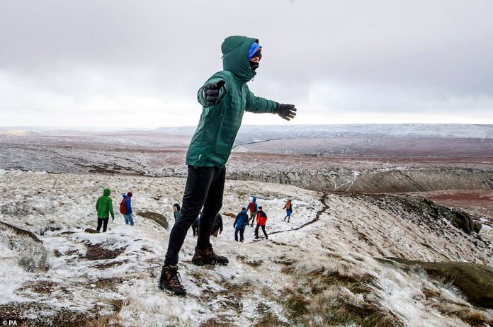 A cold snap and icy conditions still to come as Britain braces for a cold end to 2020. Pictured: hikers making the most of the stunning views in the Peak District