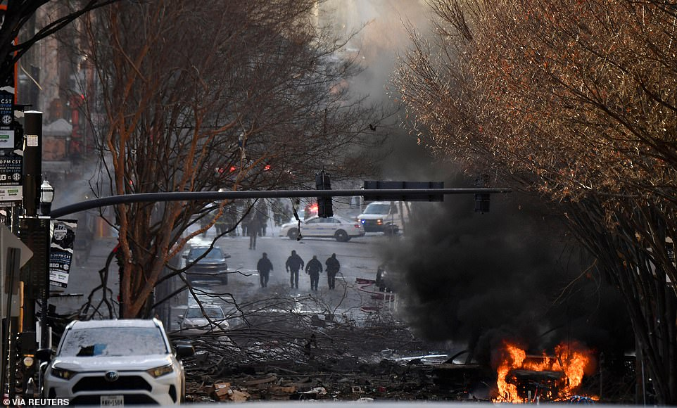 A vehicle burns near the site of an explosion in the area of Second and Commerce in Nashville on Friday