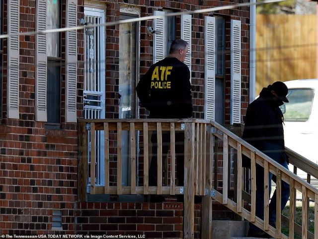 A member of theBureau of Alcohol, Tobacco, Firearms and Explosives (ATF) is seen outside the home