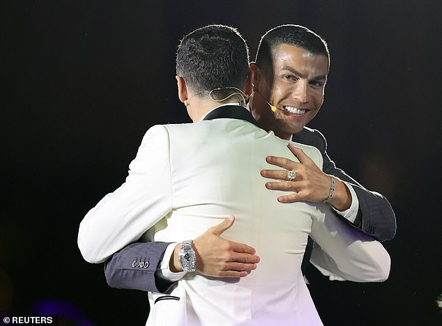 Honour: The Juventus forward, a five-time Balon d'or winner, smiled on stage in Dubai as he was named the greatest football player from 2001 to 2020