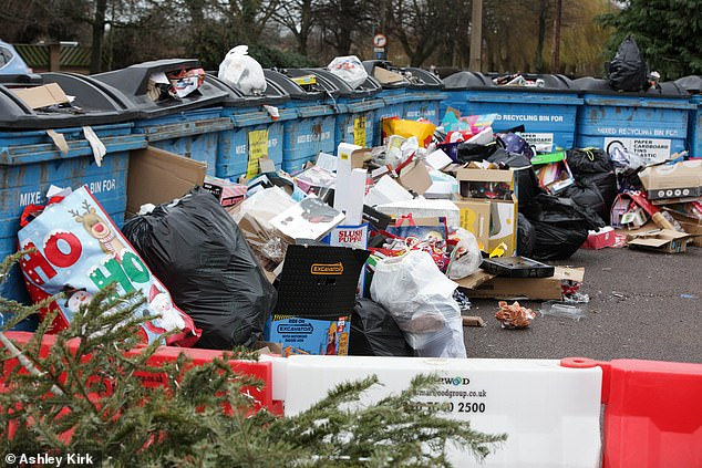 Mountains of Christmas rubbish dumped by fly tippers have been pictured overflowing at recycling areas outside UK supermarkets. Pictured is rubbish in Long Eaton, Derbyshire