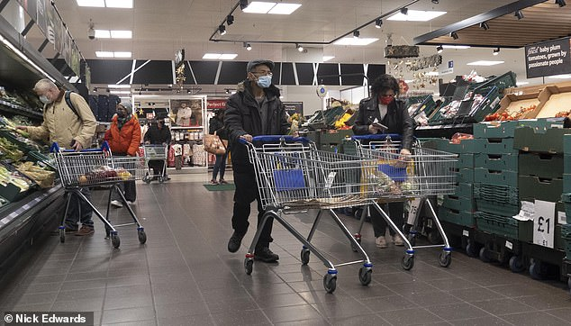 Shoppers in Tesco Extra, South East London, currently Tier 4