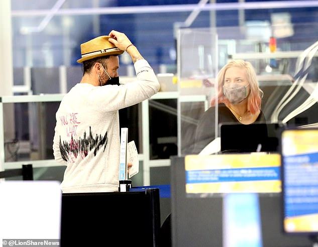 New romance? Brian Austin Green appears to have a new lady in his life, seen jetting off on a post-holiday vacation with Dancing With The Star's professional Sharna Burgess on Friday
