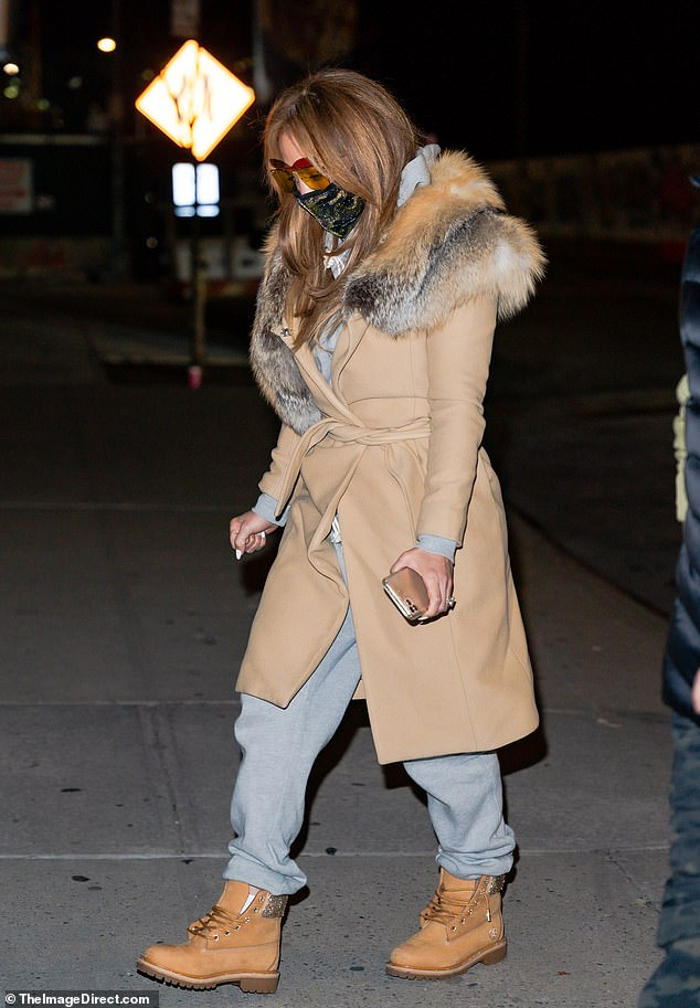 Gorgeous hair: Jlo sported a season-appropriate white manicure, and had a fist clenched in the cold weather