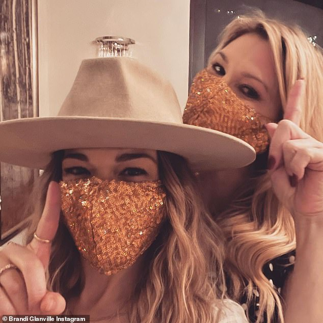 Christmas cuties: Brandi Glanvillesnapped a cozy selfie with LeAnn on Christmas Day and shared it with her 581,000 Instagram followers