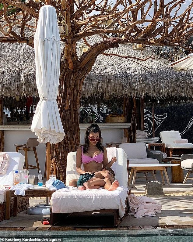 Lounging: In addition to setting pulses races with her busty solo shots, she also included some precious moments with her six-year-old son, Reign Disick, by the pool