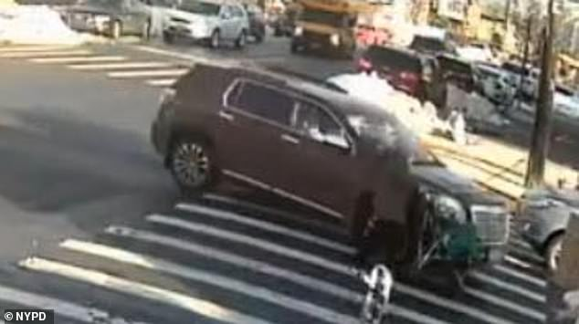 Moments later, the driver of a red GMC Terrain Denali plowed into the woman, sending her and the stroller toward the ground