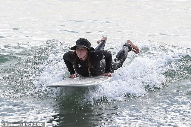 Out and about: Leighton Meester, 34, was snapped Sunday in Malibu riding the waves as she enjoyed a daytime surfing outing