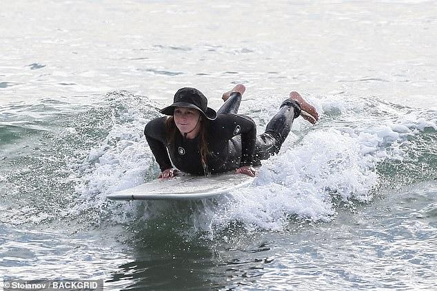Leighton Meester goes surfing in black wetsuit in Malibu