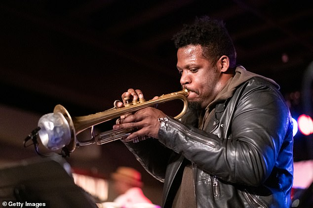 The video was posted on social media by Keyon Harrold, a professional jazz musician who has played with the likes of Common, Beyonce, Rihanna, Jay-Z, and Snoop Dogg. Harrold alleges that the woman in the video tackled his son while trying to get the phone. He is seen above performing in Texas in 2019