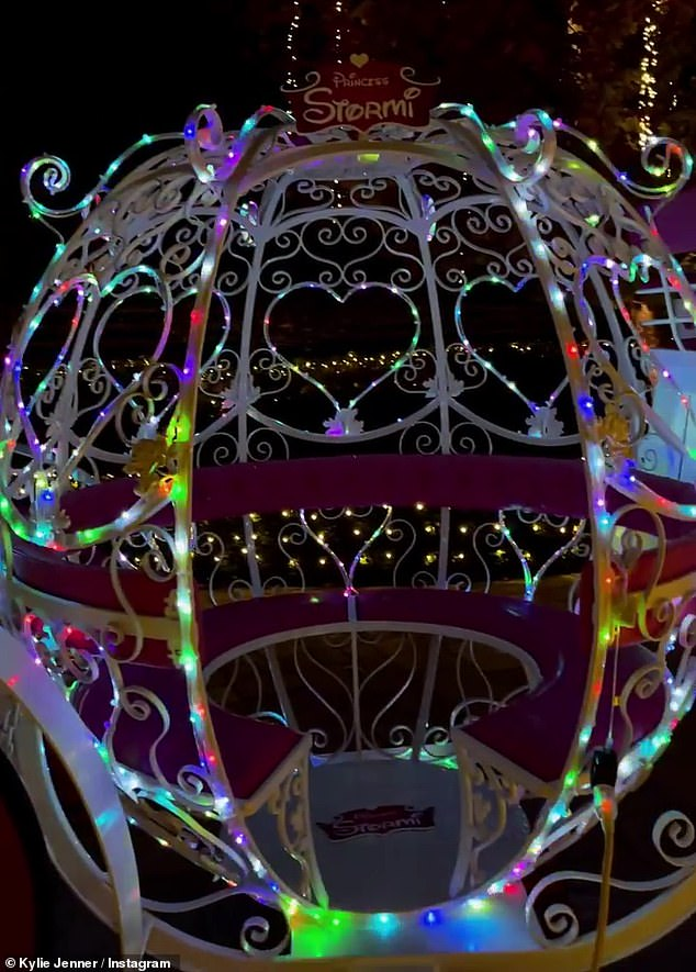 Twinkle, twinkle, enormous carriage:The carriage, shaped exactly like the enchanted pumpkin from the Disney animated classic Cinderella, was illuminated with blinking multicolored lights