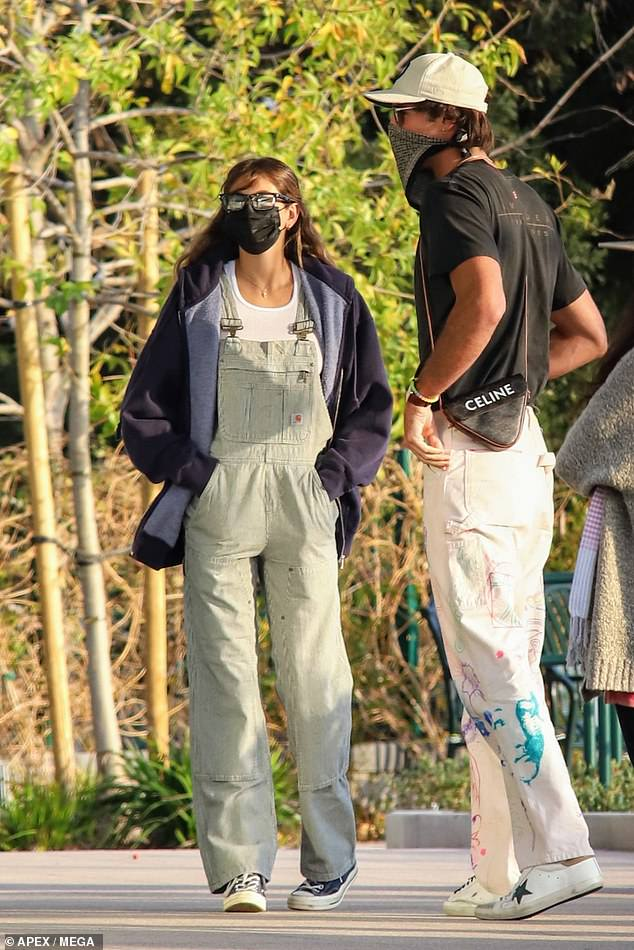 Casual Sunday: Kaia, 19, was dressed in pale green overalls with a white t-shirt and a black hoodie. Jacob, 23, wore a black tee and paint-splatter white jeans along with a baseball cap